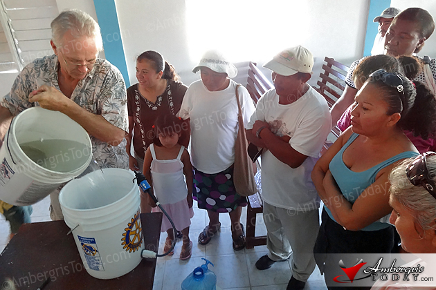 Ann Kuffner distributes water filters to residents of San Mateo, Ambergris Caye