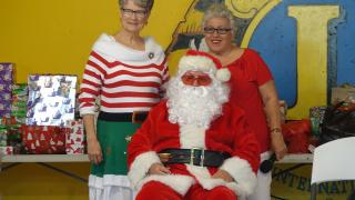 Santa Spreads Christmas Cheer at the Lions Den
