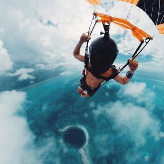 Famous Photographers Skydive the Belize Blue Hole