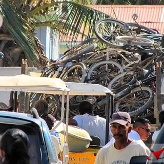 Old bicycles confiscated by Police are transported to Belize City