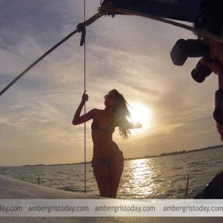 Miss Costa Rica poses in front of a beautiful sunset during sailing trip