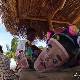 Young Garifuna Jankunu dancer prepares his costume before his dance