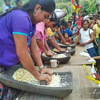 Maya women grinding corn during Maya Day 2015 competition