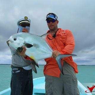 John Johandes boast Permit catch with sports fishing in San Pedro, Belize