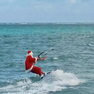 Santa Claus Kite surfing in San Pedro, Ambergris Caye, Belize