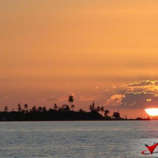 Sunsets over Hatchet Caye Resort, Belize