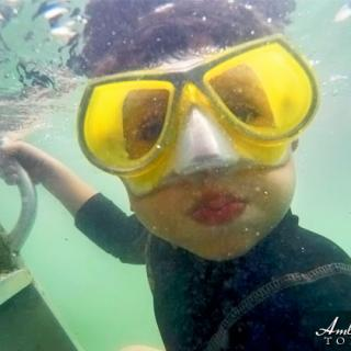 Young James enjoys a day in the water, having fun taking selfies