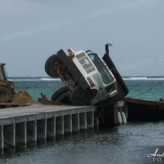 Pier Gives Way to heavy construction delivery truck
