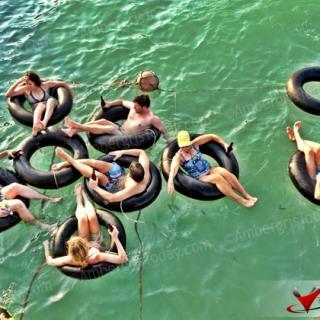 Enjoying inner tube, Beliking Beer and swimming at Palapa Bar